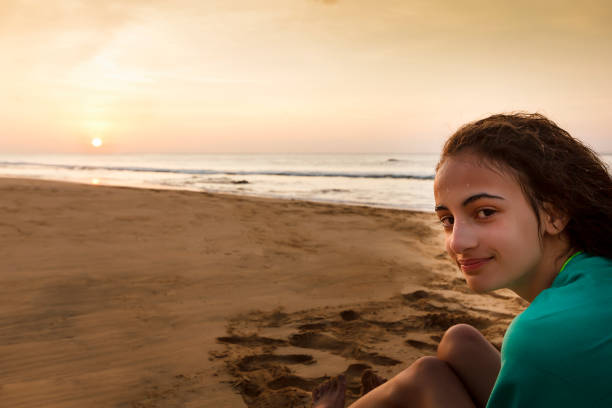 Little girl at the beach stock photo. Image of beach