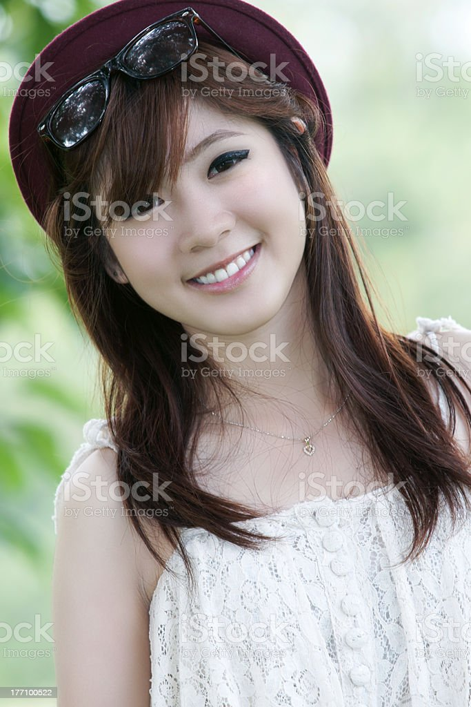A Smiling Pretty Asian Girl Wearing Sunglasses And A Hat Stock Photo - Download Image -5406