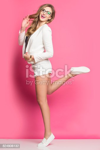 istock Smiling pretty girl on the pink background. 524906132