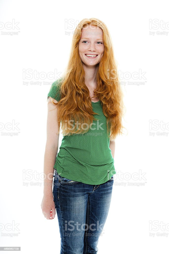 Smiling pretty girl with long red hair wearing green shirt. royalty-free stock photo