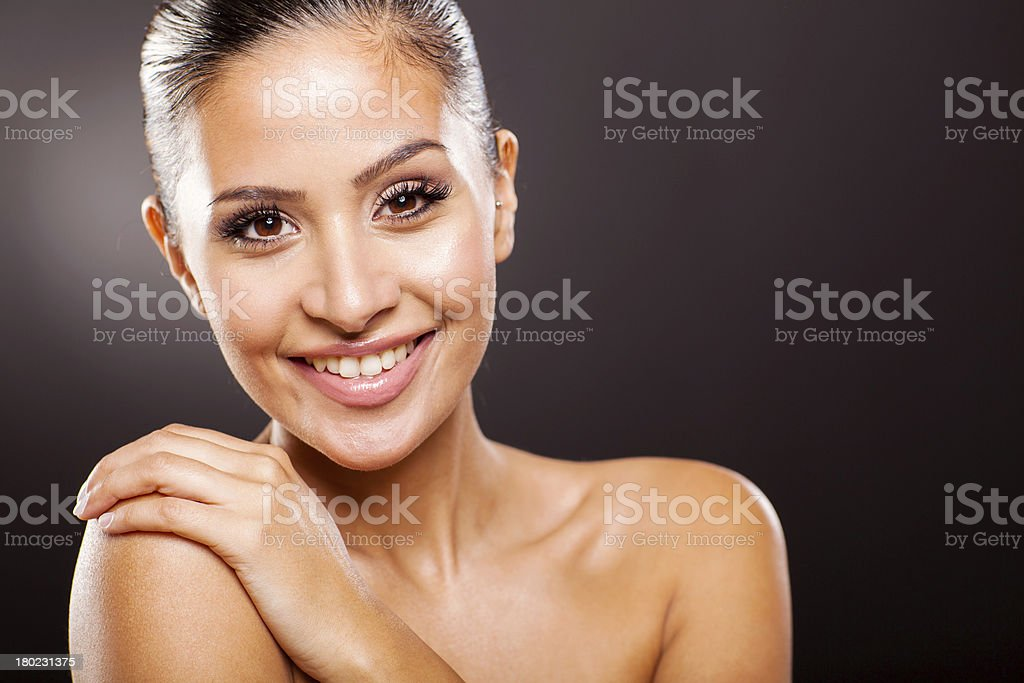 smiling pretty woman on black background royalty-free stock photo
