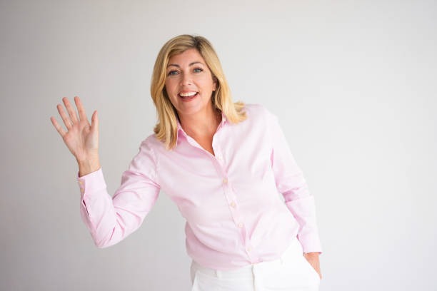 Smiling Pretty Woman Waving with Hand stock photo