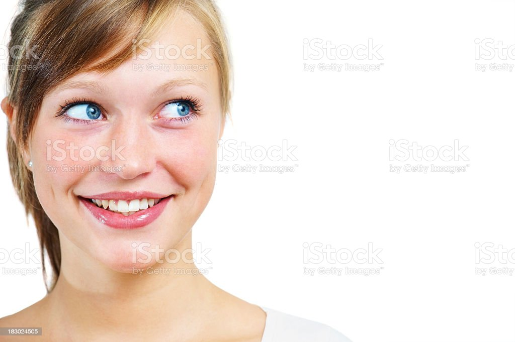 Smiling pretty young blue eyed teenager looking to side stock photo