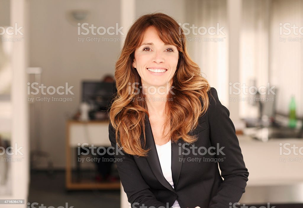 Smiling professional businesswoman on blurred background royalty-free stock photo