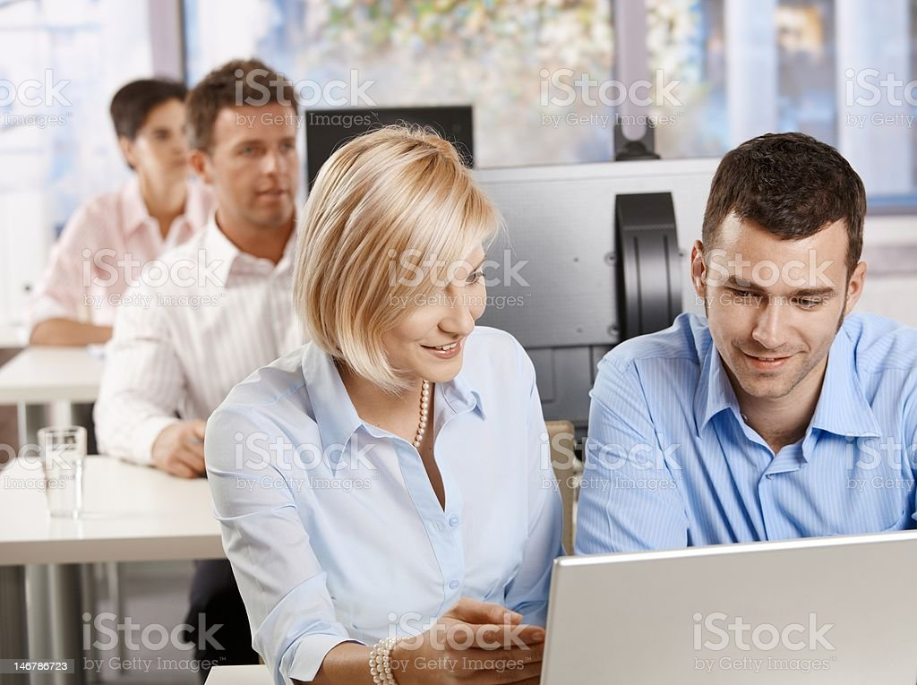 Smiling professional people with computers royalty-free stock photo