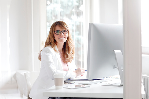 istock Smiling professional woman 517269842