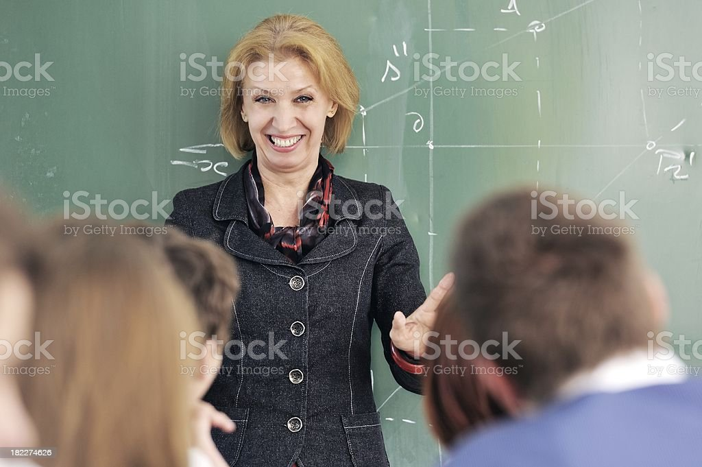 Smiling professor in a classroom stock photo