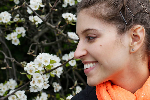 smiling profile russian outdoor girl and white blossom - whiteway english outdoor girl stock photos and pictures