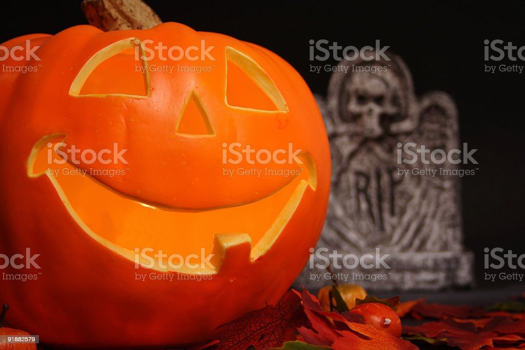 Smiling pumpkin and rip royalty-free stock photo