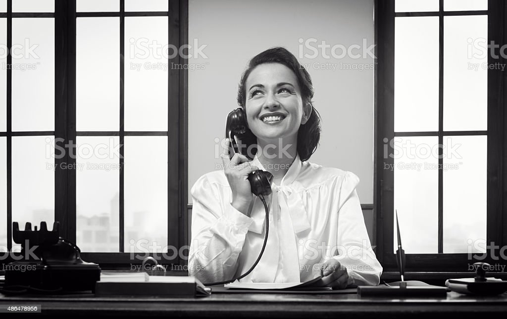 Smiling receptionist at work stock photo