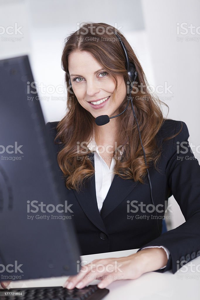 Smiling receptionist or call centre worker stock photo