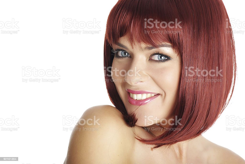 Smiling red haired woman isolated on a white background royalty-free stock photo