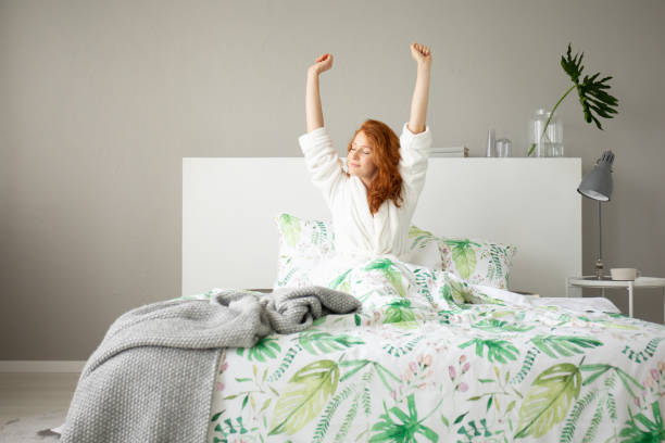 Smiling redhead girl waking up in big comfortable bed with floral picture id1091275768?b=1&k=6&m=1091275768&s=612x612&w=0&h=rrzvxo1cq1b8durom0c10y jt0tribe6q4pguu1pql4=