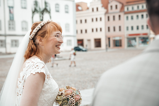 Smiling redheaded bride on her wedding day