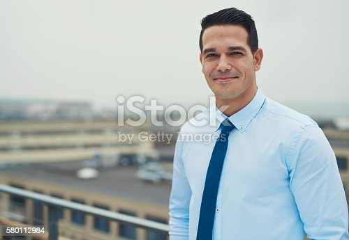 580112984 istock photo Smiling relaxed Hispanic businessman 580112984