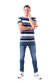 istock Smiling relaxed successful man in casual clothes looking at camera with hand on chin 1065866440