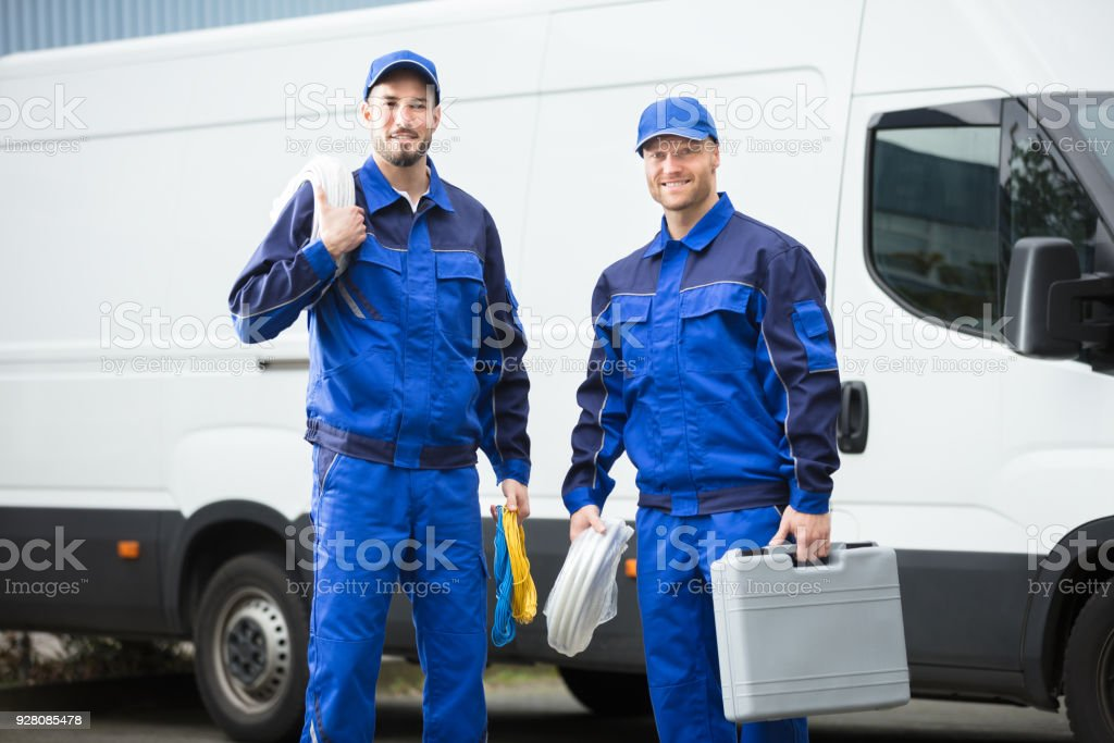 Smiling Repairman With Toolbox And Cable stock photo