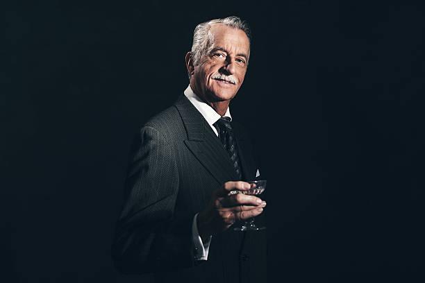 Smiling retro 1940s senior businessman holding champagne glass picture id516549150?b=1&k=6&m=516549150&s=612x612&w=0&h=fkrc3rslw tkx2cwwslnu3 d0ejpyfypyhb8sjkhm2g=