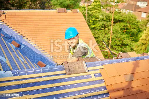 istock smiling roofer on the job 823331598