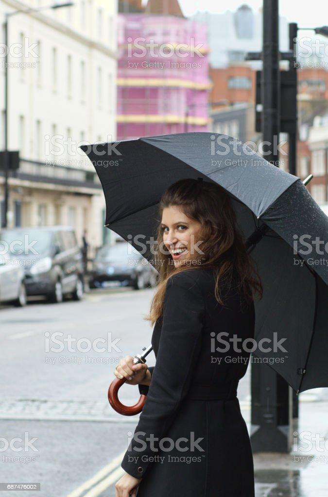Smiling Russian outdoor girl fashion umbrella in Belgravia London stock photo