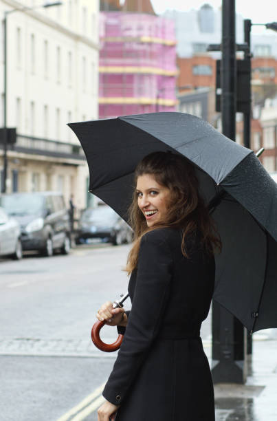 smiling russian outdoor girl fashion umbrella in belgravia london - whiteway english outdoor girl stock photos and pictures