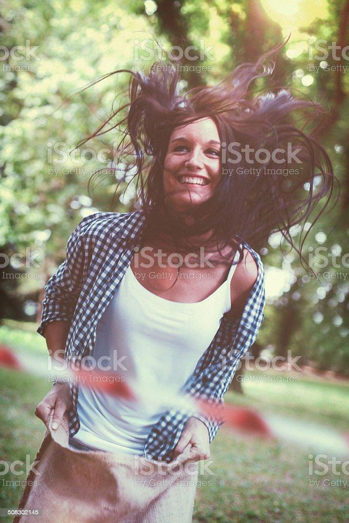 Smiling Sack Racer Crossing the Finishing stock photo
