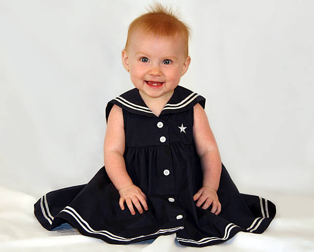 Smiling sailor baby girl stock photo