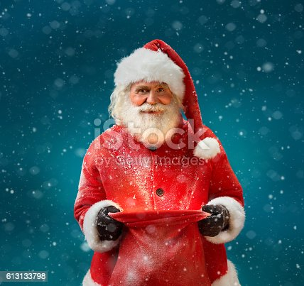 istock Smiling Santa Claus with open sack 613133798