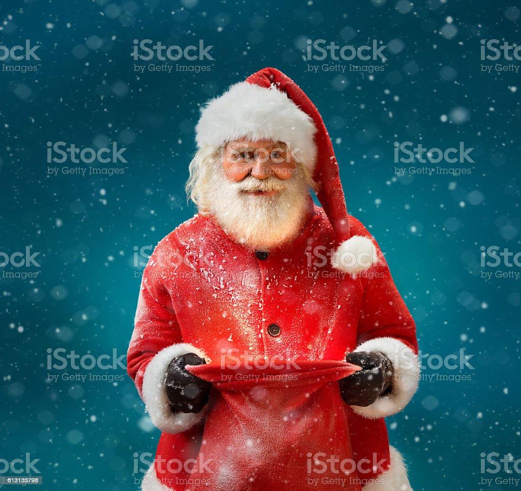 Smiling Santa Claus with open sack stock photo