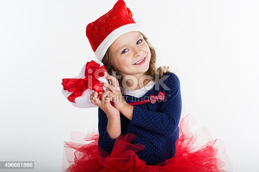1061876006istockphoto Smiling santa girl with red gift box 496661886