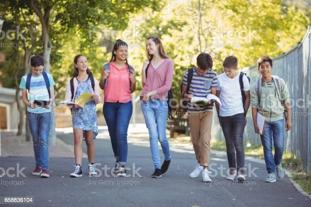 Smiling school kids walking on road in campus picture id658836104?b=1&k=6&m=658836104&s=612x612&h=opxwxwh9 cvpetraah3mmiijugtpm7rwz2hwrkaxl58=