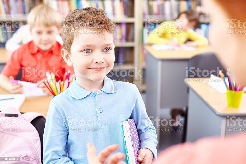 Smiling schoolboy stock photo