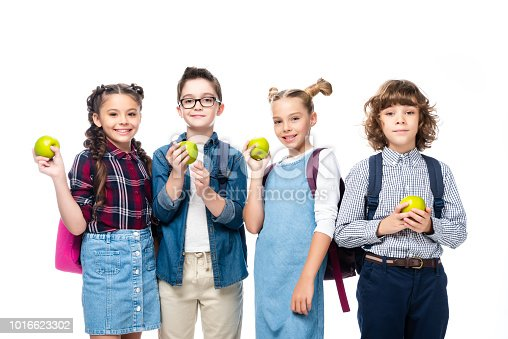 1016623732istockphoto smiling schoolchildren holding ripe apples isolated on white 1016623302