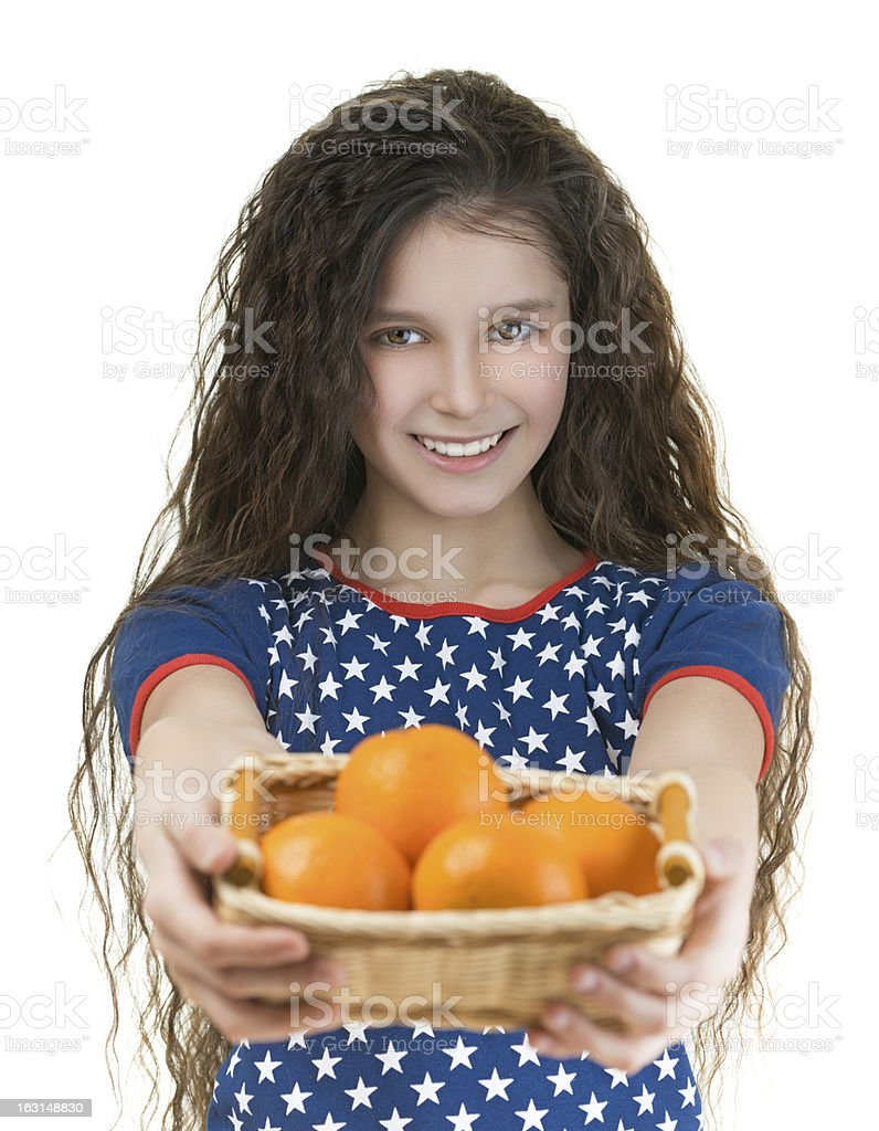 smiling schoolgirl holds basket of oranges royalty-free stock photo