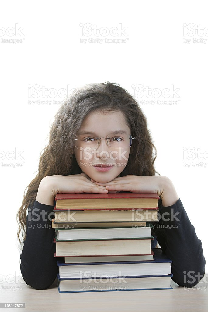 smiling schoolgirl with textbooks royalty-free stock photo