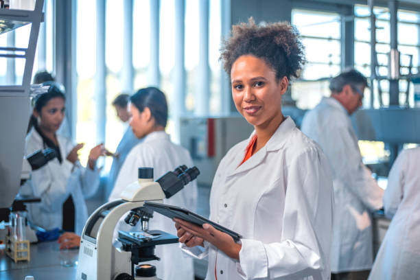 Smiling scientist with digital tablet in laboratory stock photo