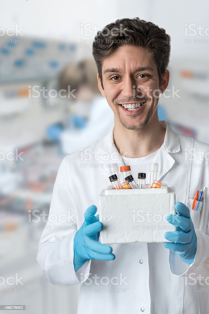 Smiling scientist works in laboratory stock photo
