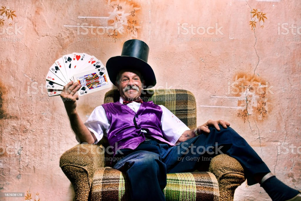 Smiling scruffy old magician royalty-free stock photo