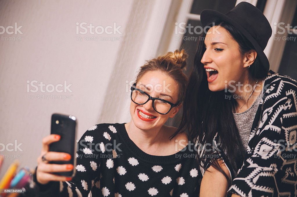smiling selfie with a smartphone royalty-free stock photo