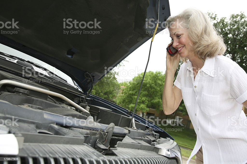 Smiling Senior Adult Woman Making Phone Call about Car Trouble royalty-free stock photo