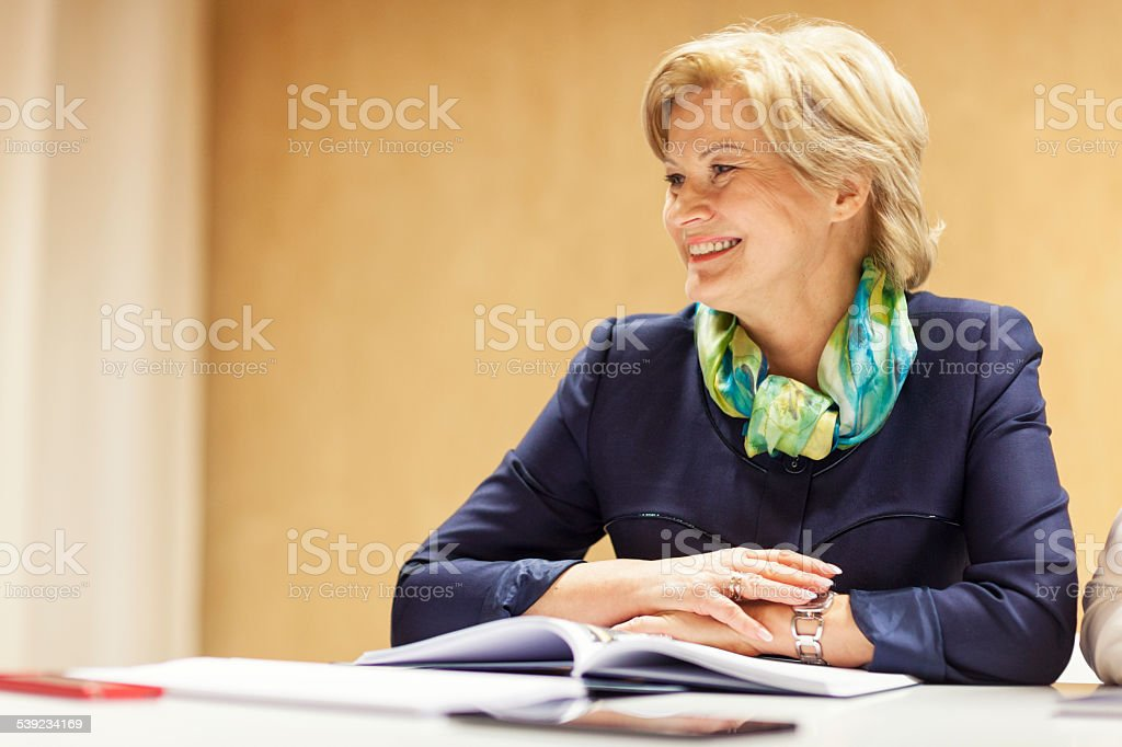 Smiling Senior Businesswoman In Office royalty-free stock photo