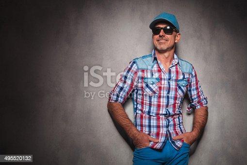 istock smiling senior casual man wearing baseball hat looking away 495520132