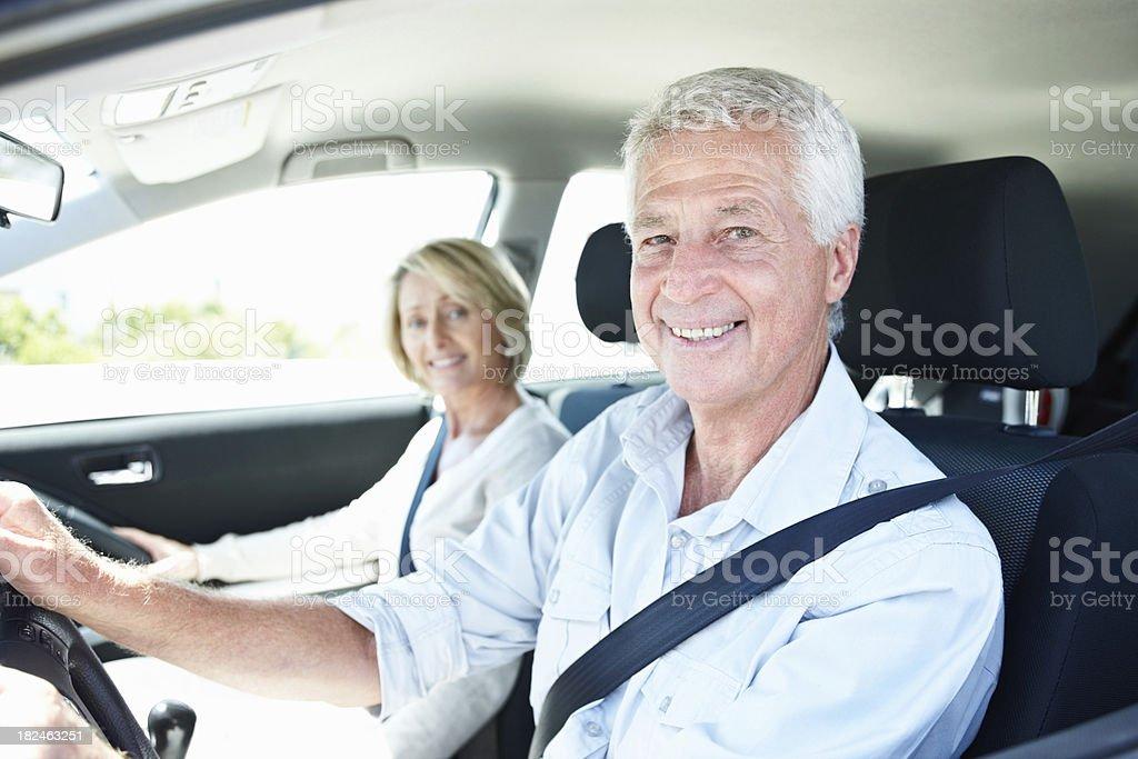 Smiling senior couple enjoying a car ride stock photo