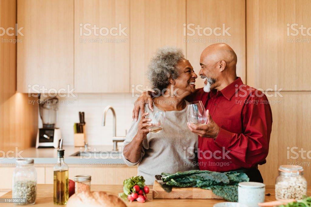 Smiling senior couple holding alcoholic drink - Royalty-free 70-79 Years Stock Photo