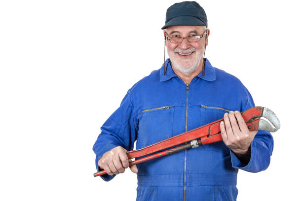 Smiling senior craftsman stock photo