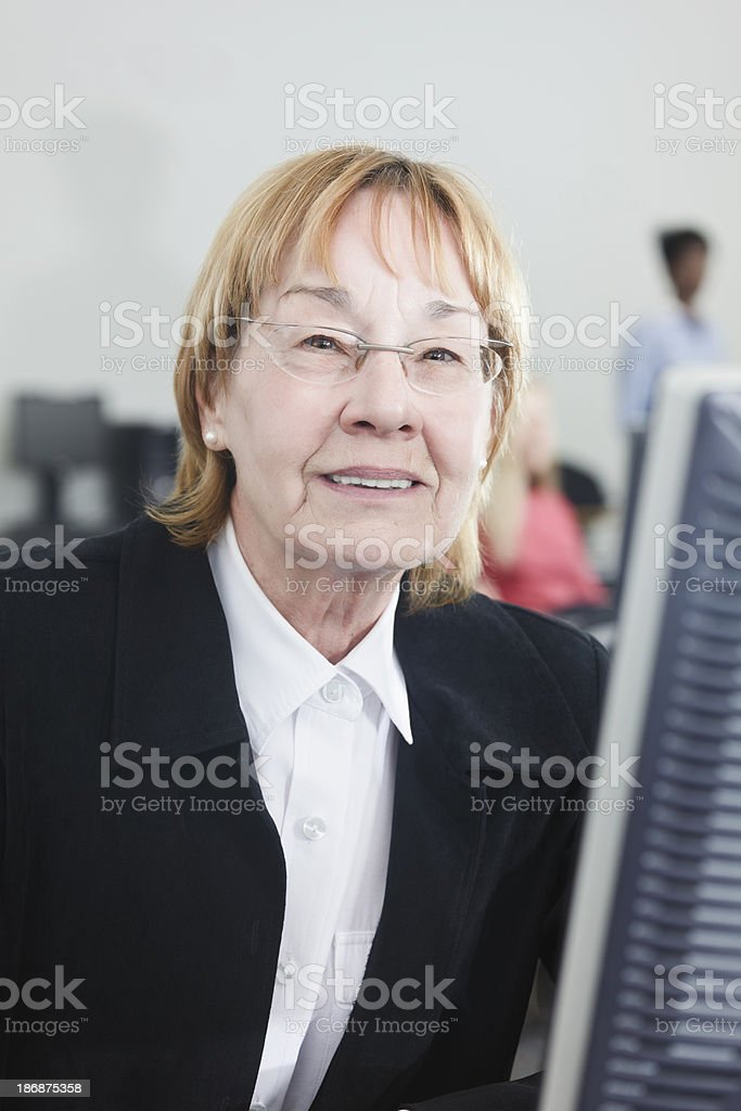 Smiling Senior in Computer Classroom royalty-free stock photo