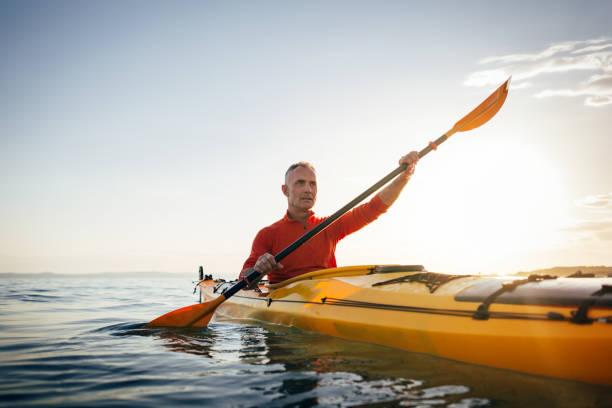 Smiling senior kayaker stock photo