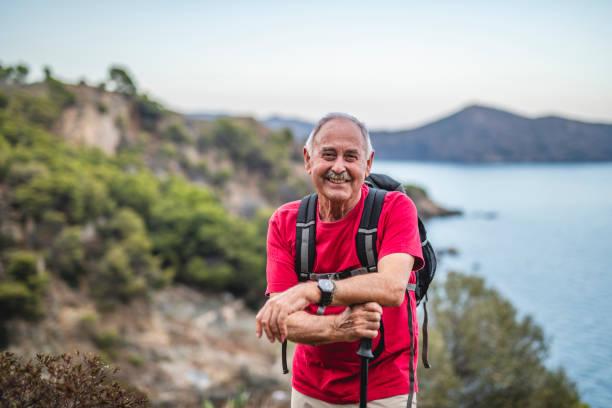 Smiling Senior Male Day Hiker on Mediterranean Coast stock photo