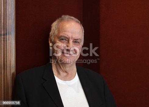 istock Smiling senior man in black blazer 966959758