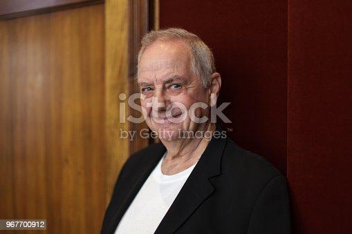 istock Smiling senior man in black blazer 967700912